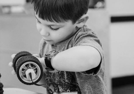 a boy learning in Ivy Kids